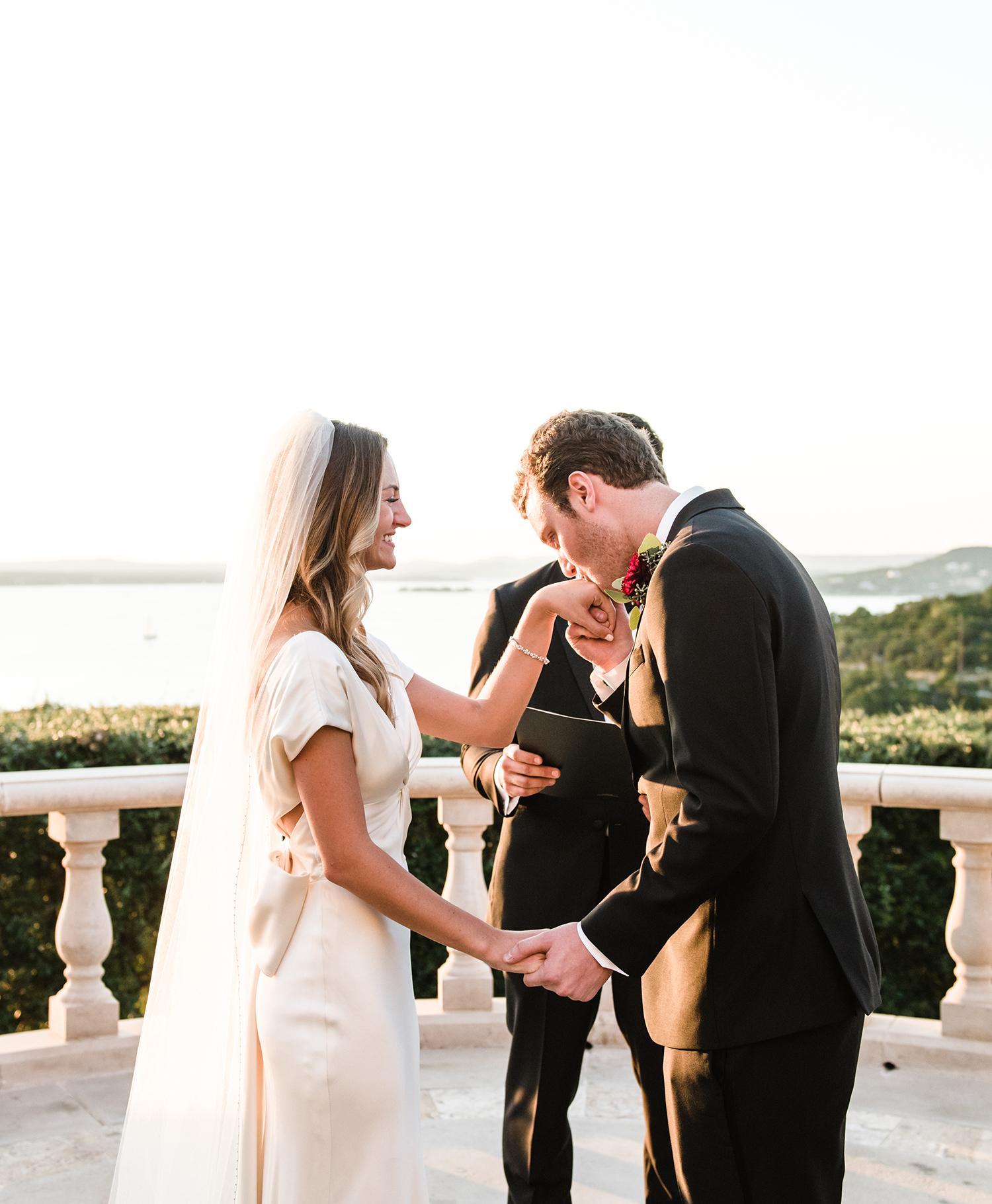 livvyland-blog-olivia-watson-wedding-villa-del-lago-austin-texas-fall-blush-burgundy-classic-romantic-altar-kiss