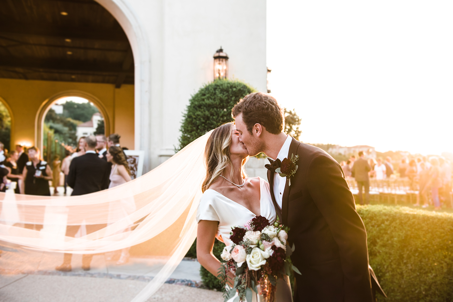 livvyland-blog-olivia-watson-wedding-villa-del-lago-austin-texas-fall-blush-burgundy-classic-romantic-bride-groom-first-kiss-1